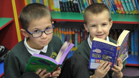 Christmas is the ideal time for reading. Children at Hillside Primary School, Ipswich, in their libr