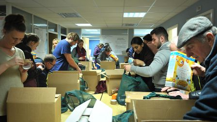 Volunteers busily packing the boxes Picture: SARAH LUCY BROWN