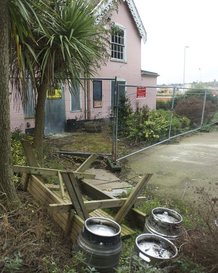 Beer kegs and a broken tables now litter the outside of the fenced off Cliff House, Ipswich, which o