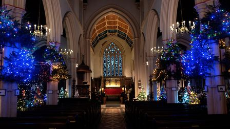 The Church of St Mary Le Tower has been illuminated with hundreds of twinkling Christmas trees Pict