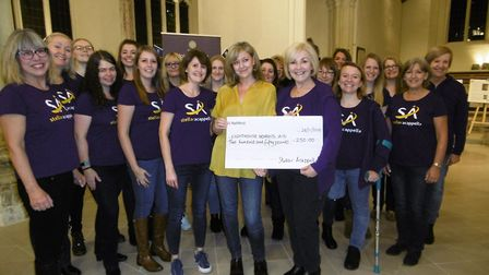 Stellar Acapella women's singing group made a cheque presentation to the Lighthouse Women's Aid char