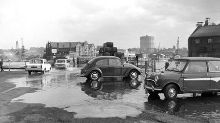 Flood water at the junction of the dock and New Cut East in October 1967. The gas holder at Ipswich