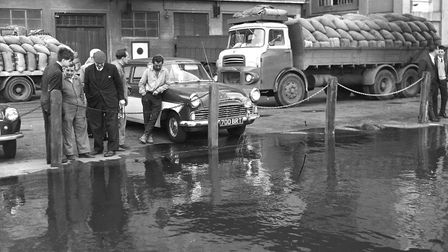 Water starts to overflow the quay at St Peters Dock, Ipswich, in October 1967. Picture: IVAN SMITH