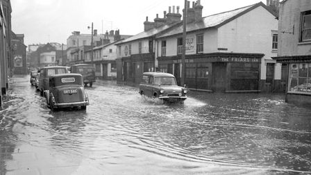 Princes Street, Ipswich, during a thunderstorm in June 1963. All of the buildings featured were demo