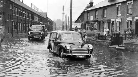 A heavy downpour in June 1958 flooded Ranelagh Road, Ipswich. On the left of this view, taken lookin