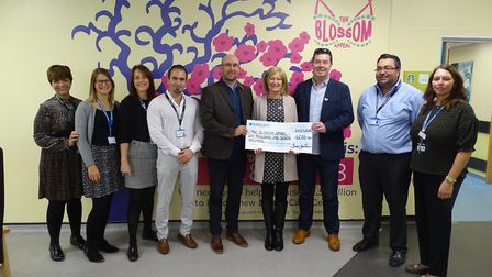 Jane and John Garvin and Simon Jay hand over their check to the Blossom Appeal Picture:COLCHESTER AN
