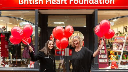 Priscilla Kojo and Tracey Linnette with balloons outiside the British Heart Foundation shop in Butte