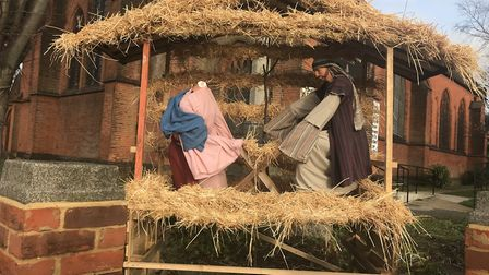 A decapitated Mary with Jesus in the nativity scene at All Saints Church, Ipswich