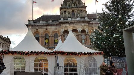 The Christmas Craft Market dominates Ipswich Cornhill and obscures the town's Christmas tree Picture