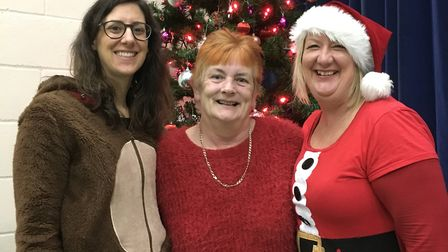 Amy Stagg and Sharon Harkin, EoE Co-Op's community engagement managers, with community hero Rosemary