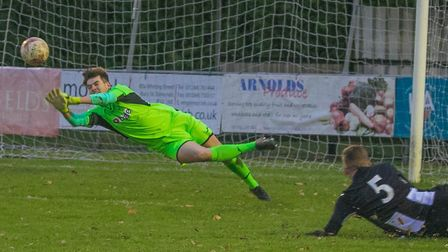 Woodbridge 'keeper Alfie Stronge pull off a fine save from a Walsham attack. Photo: PAUL LEECH