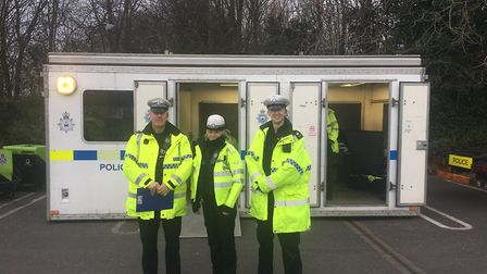 Insp Julian Ditcham stands with other officers taking party in the operation Picture: ARCHANT