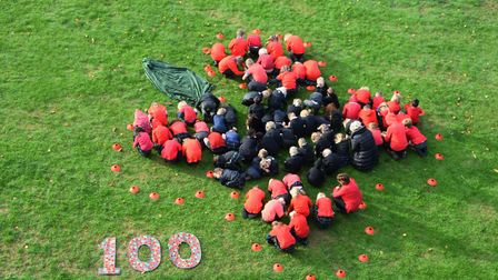 Students at Orwell Park School form a giant poppy on their school fields on November 9 as part of th