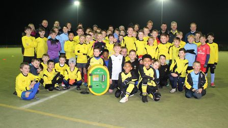 Holbrook Hornets Youth FC players and officials are pictured with the club's new defibrillator Pictu