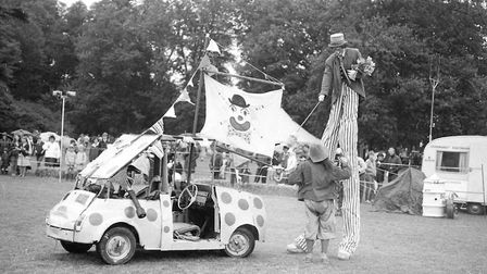Clowns entertaining crowds with a rather interesting looking car Picture: ARCHANT