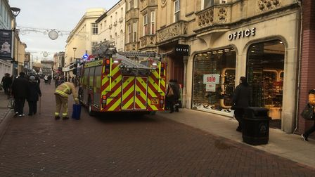 Fire fighters called to catch the pigeon at WH Smith in Ipswich town centre. Picture: PAUL GEATER