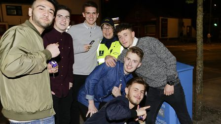 A town pastor with revellers in Ipswich town centre. Picture: KEITH MINDHAM