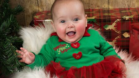 Six month old Temperance is Santa's smiley helper Picture: RUTH LEACH