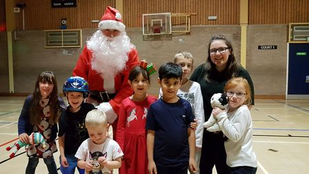 Roller skating Santa with some young skaters Picture: RACHEL EDGE