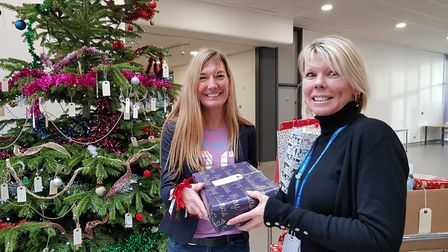 Lisa handing over the gifts to Tess Aristodemou, CEO of Aspect Living Foundation Suffolk Meals on Wh
