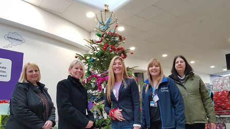 Staff at BT donated gifts in aid of Aspect Living's Meals on Wheels service which were left under th