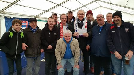 Members of Fortuna Blues Supporters Club handed their contribution towards the Kevin Battie Statue C