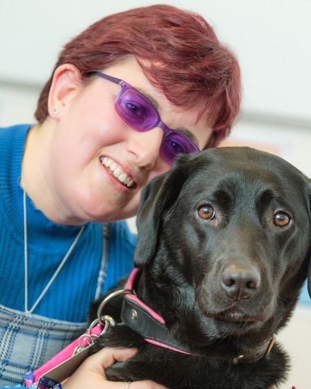 Hannah Mills and her guide dog Joy Picture: MARK HEWLETT