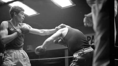 A boxer takes a left hook at his opponent Picture: ARCHANT