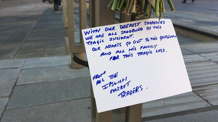 Market traders have left a floral tribute to John Stow at the Cornhill Picture: PAUL GEATER