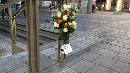 Flowers left on the Cornhill by the Ipswich market traders Picture: PAUL GEATER