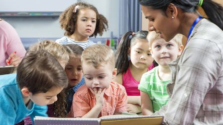 Reading to a nursery class. Getty Images/iStockphoto