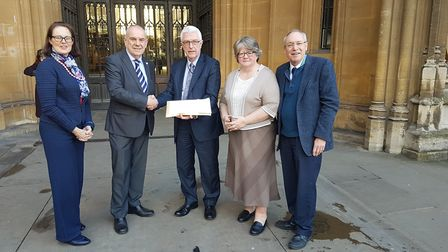 Mayor of Felixstowe Graham Newman hands over a petition to Tony Ginty, from M&S. Also pictured are F