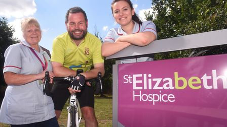 Adrian Rawlinson (centre) has previously fundraised for St Elizabeth Hospice now he is their Directo
