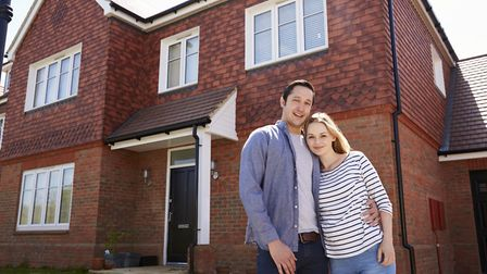 A young couple outside their new home. Lloyds Bank has launched a new deposit-free mortgage, support