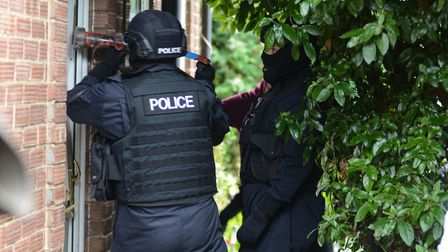 Officers from Suffolk police carry out a drug raid in Ipswich Picture: KAREN WILLIE