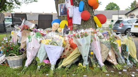 Tributes are left in memory of Tavis Spencer Aitkins on Packard Avenue, Ipswich Picture: SARAH LUC