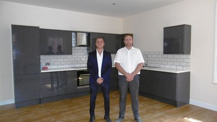 Joe Fogel and Levi Draycott inside one of the apartments that were created in the former First Floor