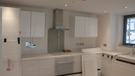 The nearly-completed kitchen in one of the first flats to be handed over at the Winerack. Picture: N