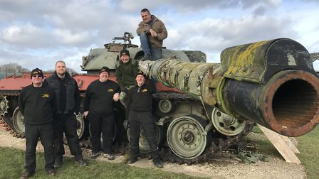All but one of the volunteers helping to restore a Chieftain tank at Raydon Airfield are ex-military