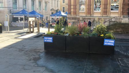 The new planters on Ipswich Cornhill - with signs to warn visitors about the new steps. Picture: PAU