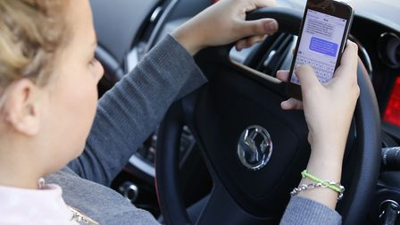A traffic survey observed one in a hundred drivers using a hand-held mobile phone Picture: JONATHAN