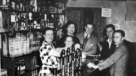 Who was behind the bar at the Railway Tavern in Burrell Road, Ipswich, when this photograph was take