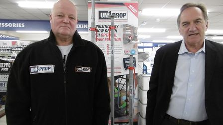 Blacksmith Tom Moye and David Marr, managing director of Uni-Prop International, with a display of t