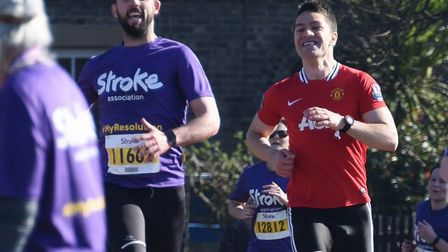 Francisco Lopez, left, wins with Mircea Batog in second in the 10K Resolution Run in aid of the Stro