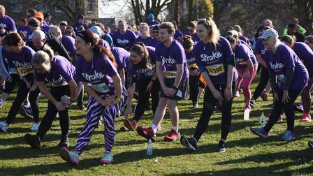 Competitors warm up for the Resolution Run in aid of the Stroke Association at Ipswich's Christchurc