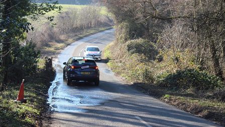 Cars, tractors and lorries are veering across the road in a bit to avoid the pothole in Nacton Pictu