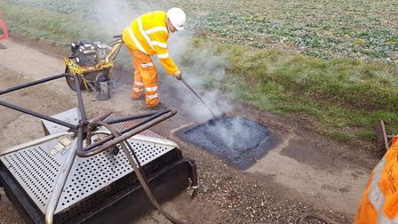 Suffolk County Council highways cabinet member Mary Evans visits teams repairing potholes with new t
