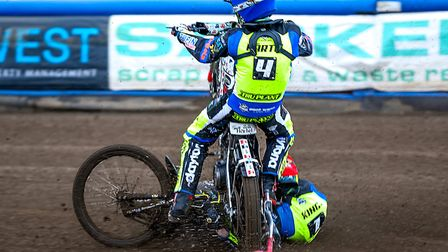 Michael Hartel (blue helmet) and team-mate Danny King crash and Hartel rides over King's arm, causin