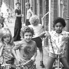 The youngster in the background of this photograph in July 1976 seems to have taken the fashion of f