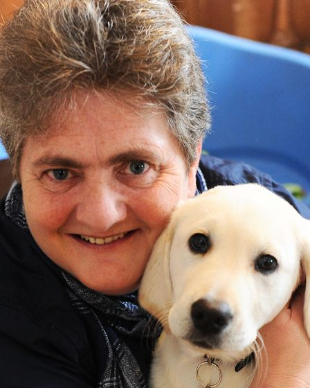 Penny Parker with previous guide dog puppy Sky. Picture: LUCY TAYLOR